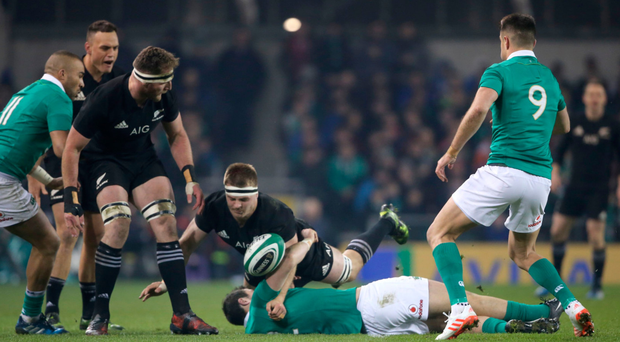 Ireland's Robbie Henshaw is tackled by New Zealand's Sam Cane: '. . . the point of contact was shoulder to face and that is a red card.' Photo: PA