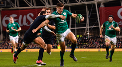Jacob Stockdale on his way to scoring Ireland's second try despite the efforts of Argentina's Joaquin Tuculet at the Aviva Stadium. Photo: Sportsfile