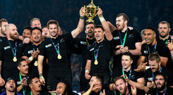 All Blacks captain Richie McCaw and Dan Carter lift the Webb Ellis Cup surrounded by their team-mates after the 2015 Rugby World Cup final victory over Australia at Twickenham. Photo: Sportsfile