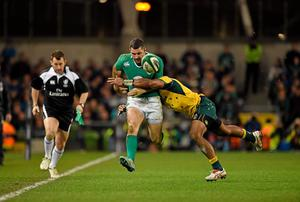 Rob Kearney, Ireland, is tackled by Henry Speight, Australia