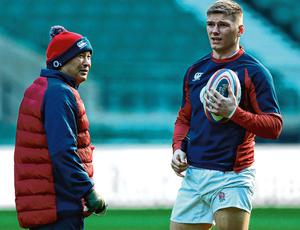 England head coach Eddie Jones in conversation with Owen Farrell during yesterday's captain's run at Twickenham. Photo: Getty Images