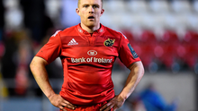 Munster's Keith Earls stands dejected his side's defeat to Leicester