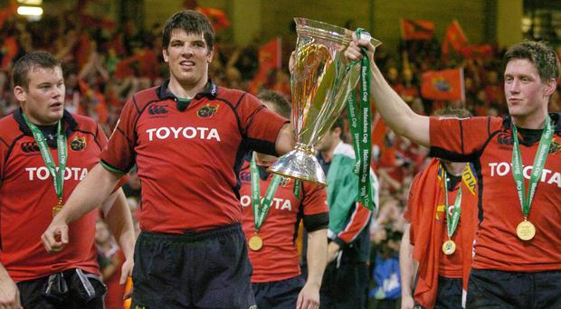 Munster's Donncha O'Callaghan, left, and Ronan O'Gara with the Heineken Cup after then Heineken Cup Final in May 2006