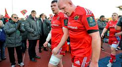 Munster players Peter O'Mahony, left, and Paul O'Connell leave the pitch after the game