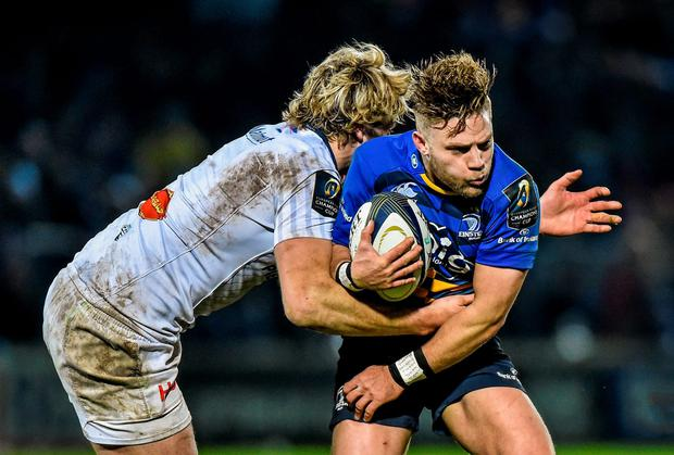Ian Madigan, Leinster, is tackled by Richie Gray, Castres