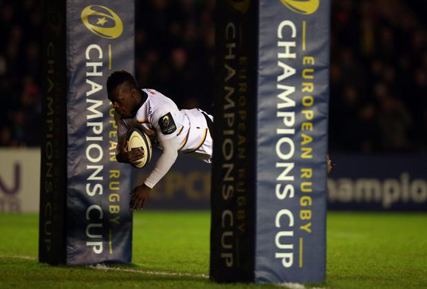Christian Wade of Wasps scores the opening try during the European Rugby Champions Cup match between Harlequins and Wasps