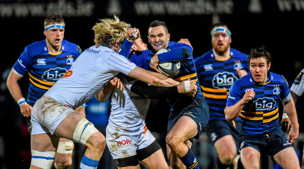 Dave Kearney is tackled by Richie Gray, left, and Rory Kockott