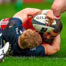 Simon Zebo, Munster, scores his side's first try despite the efforts of David Seymour, Sale Sharks