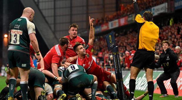Munster's Conor Murray celebrates as referee Romain Poite awards the try to his team-mate James Cronin