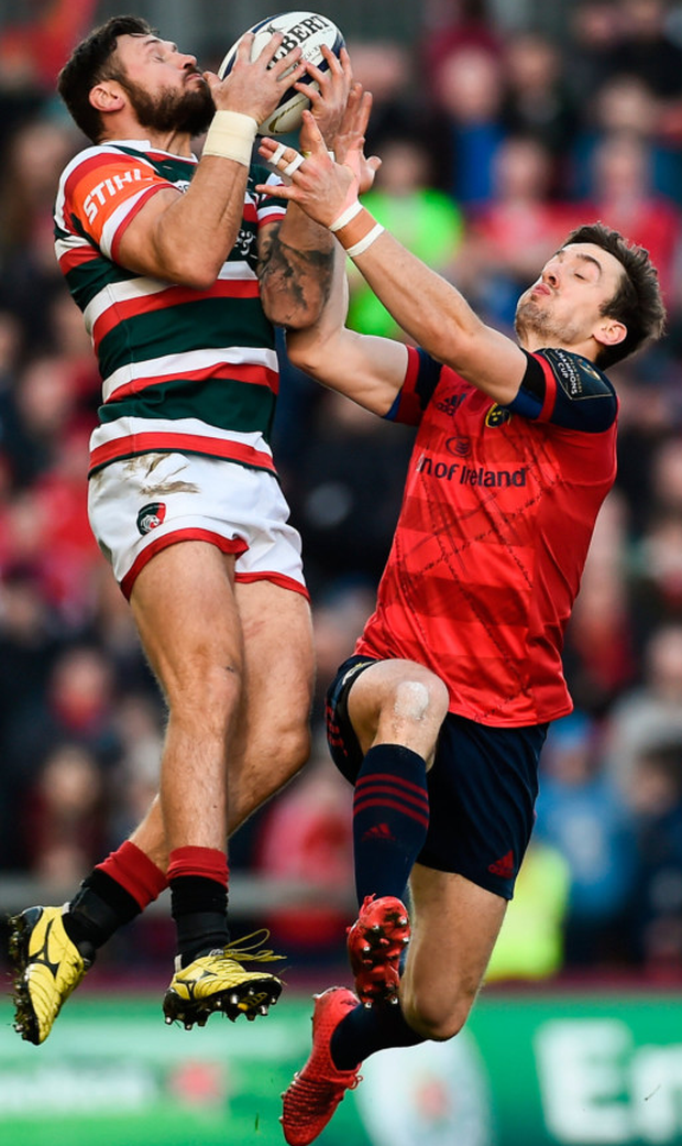 Leicester's Adam Thompstone and Darren Sweetnam of Munster battle for the ball in Thomond Park. Photo: Sportsfile