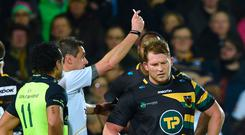 Dylan Hartley is shown a red card by referee Jerome Garces on Friday night