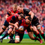 Billy Holland, supported by Donnacha Ryan, is tackled by Schalk Burger of Saracens. Photo: Ramsey Cardy