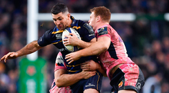 Rob Kearney of Leinster is tackled by Tomas Francis, behind, and Sam Simmonds of Exeter Chiefs during the European Rugby Champions Cup Pool 3 Round 4 match between Leinster and Exeter Chiefs at the Aviva Stadium in Dublin. Photo by Brendan Moran