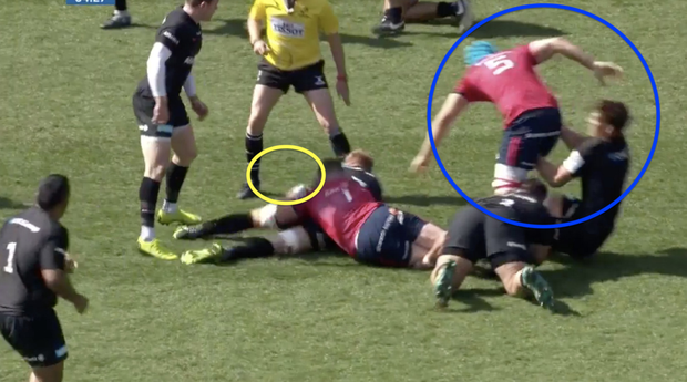 Tadhg Beirne being prevented from getting to the ball by Michael Rhodes