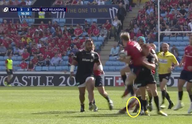 Mike Haley is tackled by Owen Farrell while his feet are still in the air