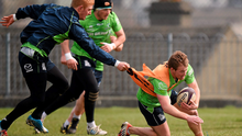 Connacht's Kieran Marmion is tackled by Darragh Leader during training ahead of the game against Gloucester