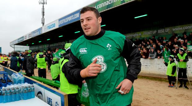 Ireland's Robbie Henshaw makes his way onto the pitch for the start of squad training