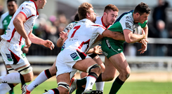 Robbie Henshaw is tackled by Ulster's Chris Henry, left, and Paddy Jackson