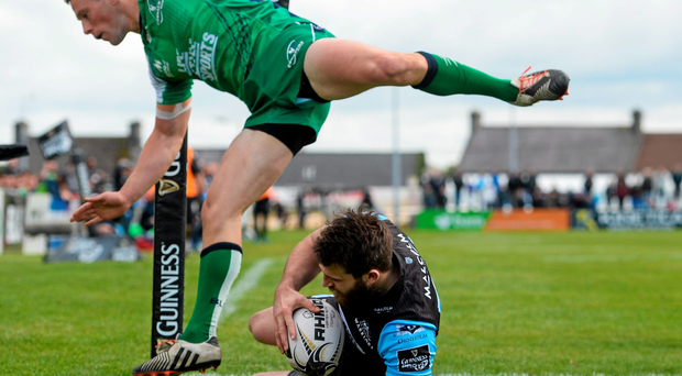Tommy Seymour, Glasgow Warriors, scores his sides fifth try dispite the tackle of John Cooney during Connacht's disappointing defeat at the Sportsground last weekend