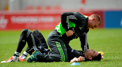 Keith Earls and Conor Murray share a joke at the end of training