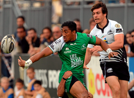 Connacht's Bundee Aki releases the ball under pressure from the Zebre defence