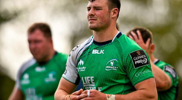 Robbie Henshaw leaves the field after defeat to Ospreys