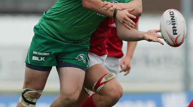 Munster's Gavin Coombes tackles Connacht's Mark O'Dowd during their U-20s inter-provincial