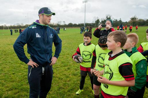 Ireland international Robbie Henshaw gives some advice to youngsters at the Mazda Rugby Roadshow with Connacht Rugby in Buccaneers RFC, Athlone last weekend. Connacht players Kieran Marmion, Denis Buckley, Robbie Henshaw and Tom McCartney also put the children through their paces