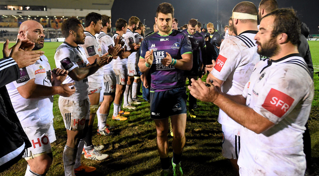 Tiernan O'Halloran is applauded off the pitch by Brive players after Connacht's Challenge Cup victory last weekend