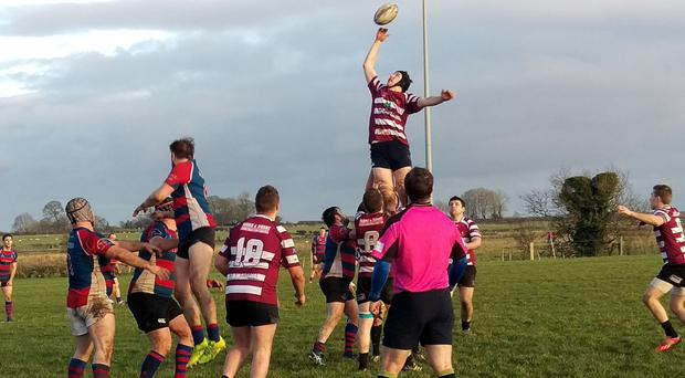 Tom Oates rising highest to claim a lineout for Creggs in their victory over Tuam
