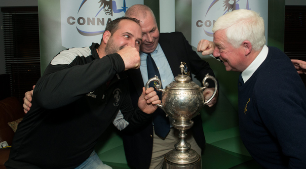 Chairman of rugby Tony McDonagh oversees the tension between Fergal Leonard of Claremorris and Tuam's John Carr at the draw for the Heineken Junior Cup
