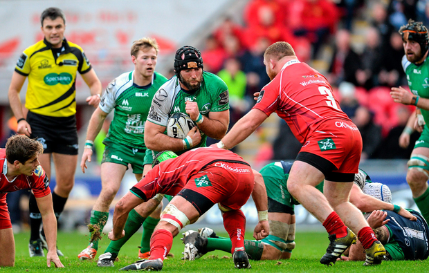 John Muldoon is tackled by Tom Price and Samson Lee of Scarlets during the Pro12 clash last weekend (SPORTSFILE)