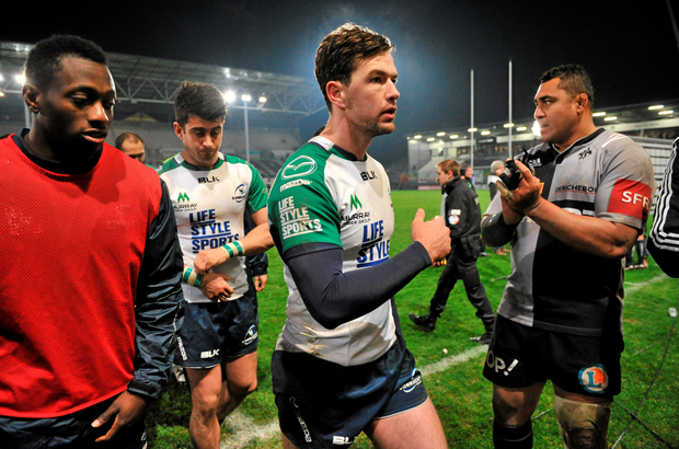 Danie Poolman and Tiernan O'Halloran leave the pitch following their defeat to Brive. Photo: Ray Ryan / Sportsfile