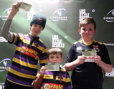 Loughrea members receive their tickets to the Enisei game