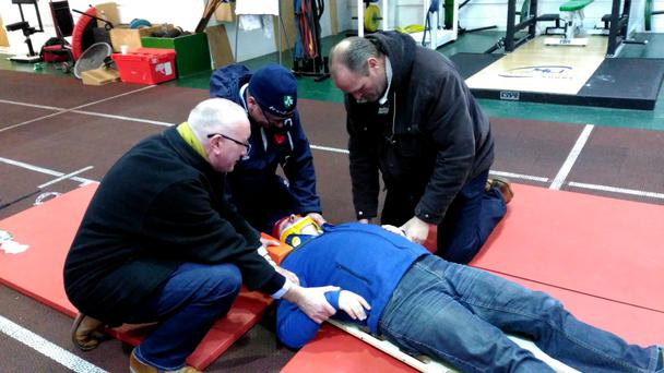 Members of Na Bairneachai practise SAFE first aid on club president Tony Grealy