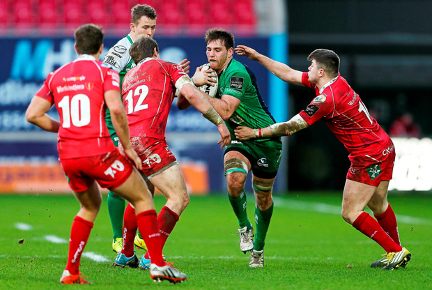 Connacht's Jake Heenan is tackled by Scarlets pair Hadleigh Parkes and Steffan Evans. SPORTSFILE