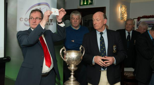 Claremorris president Jarlath Sweeney and branch president conduct the draw