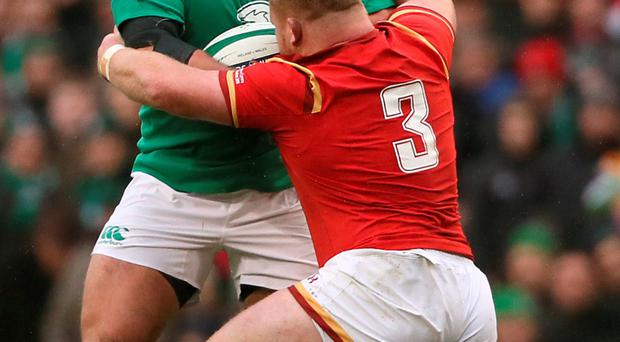 Ireland's Nathan White is tackled by Wales' Samson Lee at the Aviva Stadium last Sunday. Photo: PA