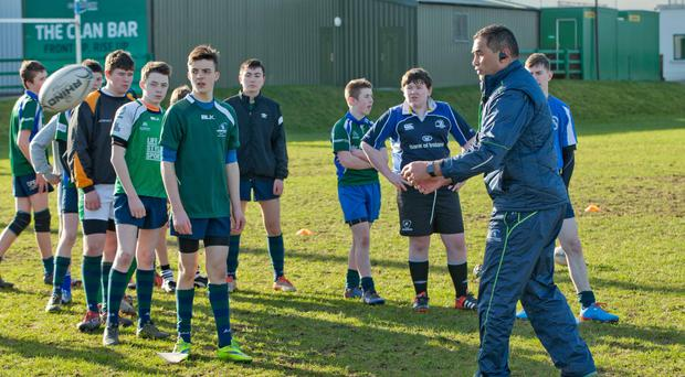 Pat Lam with St Paul's Oughterard pupils (INPHO)
