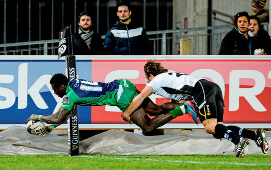 Niyi Adeolokun scores a try for Connacht in Parma despite thebest efforts of Zebre's Tommaso Boni (SPORTSFILE)