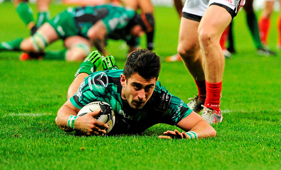 Tiernan O'Halloran scores a try against Munster earlier this season – and he will be hoping for similar success against Leinster tomorrow (SPORTSFILE)
