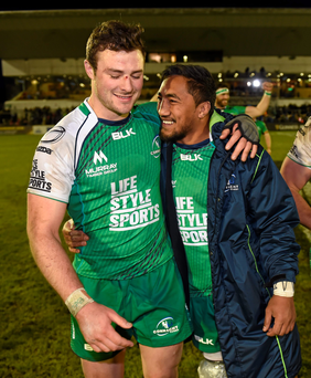 Rob Henshaw and Bundee Aki celebrate Connacht's victory over Munster (SPORTSFILE)
