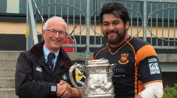 Michael Cunningham (Connacht Branch IRFU) presents the Connacht Senior League trophy to Buccaneers captain Kolo Kiripati