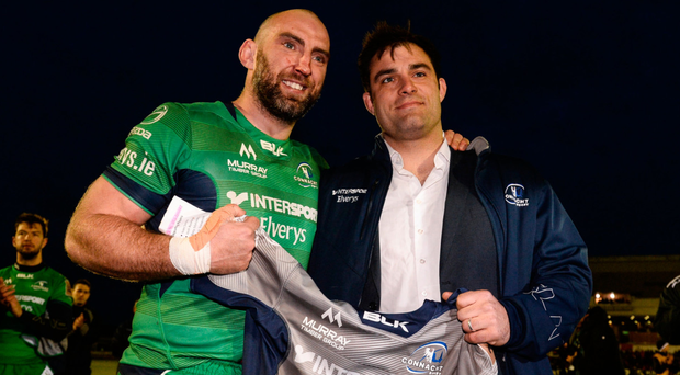 John Muldoon presents a commemorative jersey to the departing Ronan Loughney on behalf of Connacht Rugby after the Scarlets defeat. Photo: Sportsfile