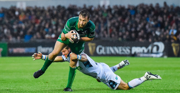 Jack Carty is tackled by Lee Jones of Glasgow Warriors during the Guinness PRO14 Round 1 match between Connacht Rugby and Glasgow Warriors at the Sportsground in Galway. Photo by Matt Browne/Sportsfile
