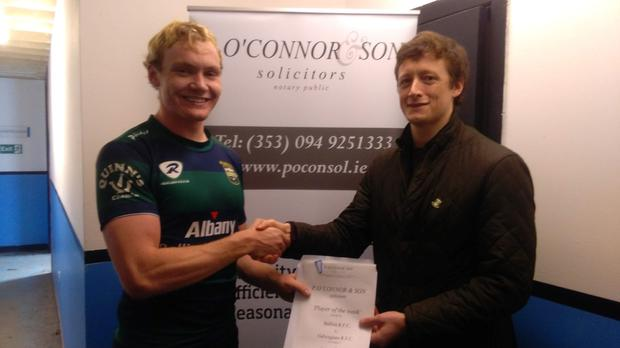 Ballina centre Calum Quinn receiving the Player of The Week award sponsored by P O'Connor & Son, Solicitors Swinford from William O'Connor, following his side's 53-5 win over Galwegians