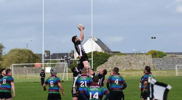 Ballinrobe captain David Madden being lifted in a line out