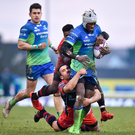 Connacht's Niyi Adeolokun is tackled by Daniel Ikpefan and Maxime Veau of Oyonnax Photo: Sportsfile
