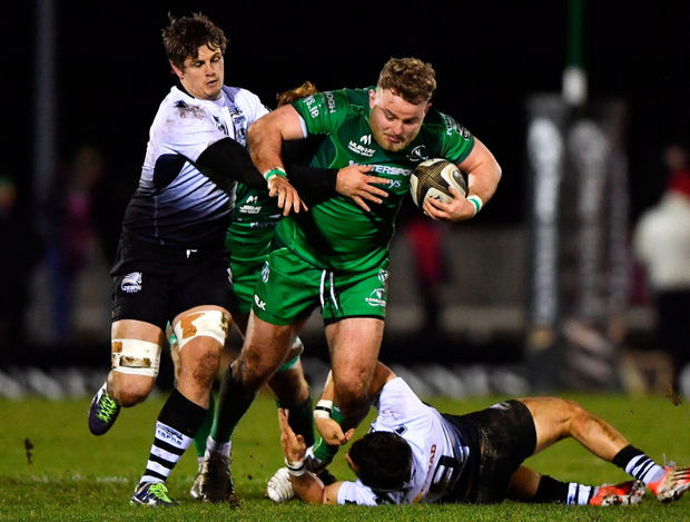 Finlay Bealham tries to escape the attentions of Zebre's Johan Meyer and Guglielmo Palazzani. Photo: Sportsfile