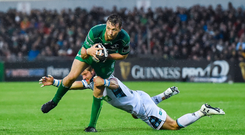 Jack Carty, pictured here trying to get away from Lee Jones of Glasgow Warriors, always sees the glass as being half-full rather than half-empty